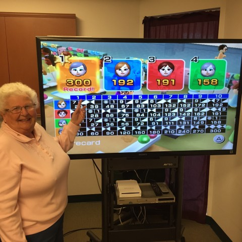 Dolores L. bowls her first 300 game
