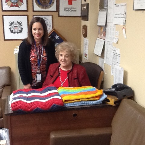 Hilda donating Afghans to the VA Medical Center at Castle Point!