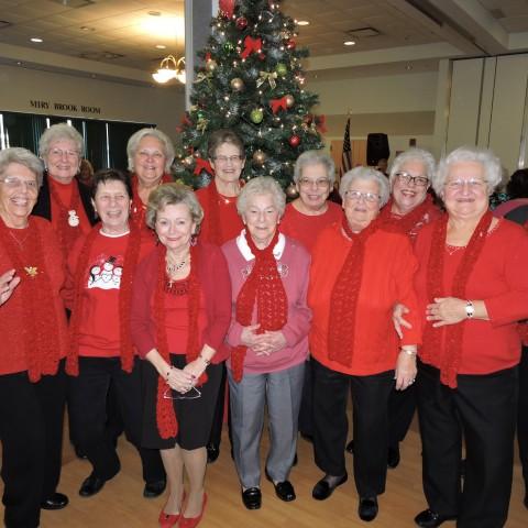 Generous Group of Ladies Spreading Cheer around the tree