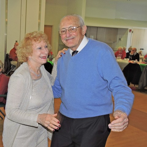 Sharing a Dance at the Annual Jingle Mingle
