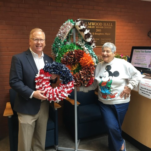 Mayor Mark and Angie showing off the Fabric Wreaths to be sold at the Craft & Bake Sale