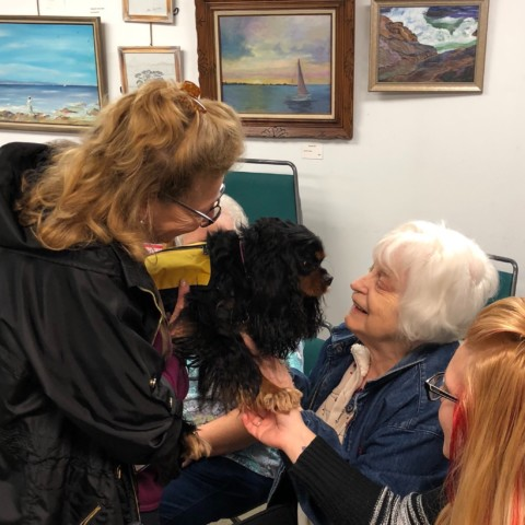 Perdetta visits with certified therapy dog Baci